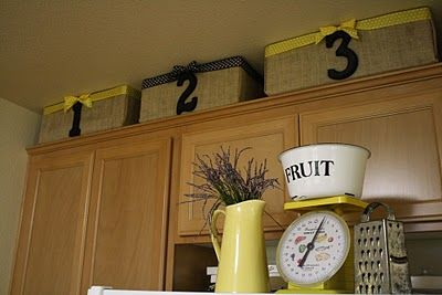 Burlap bins. Clever idea to reuse old cardboard boxes!