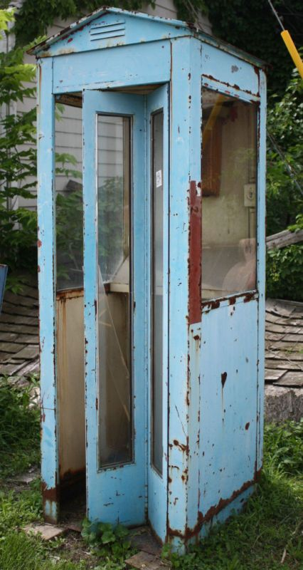 Old telephone booth in chippy blue.  Want this in my living room