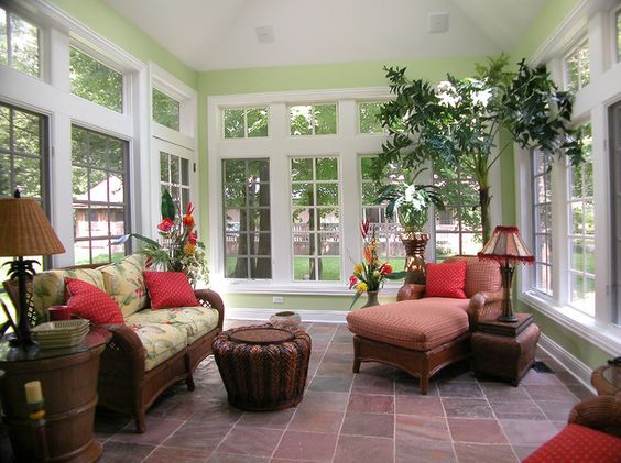 Inside sunrooms interior decorating with sofa and plants for Tropical interior paint colors