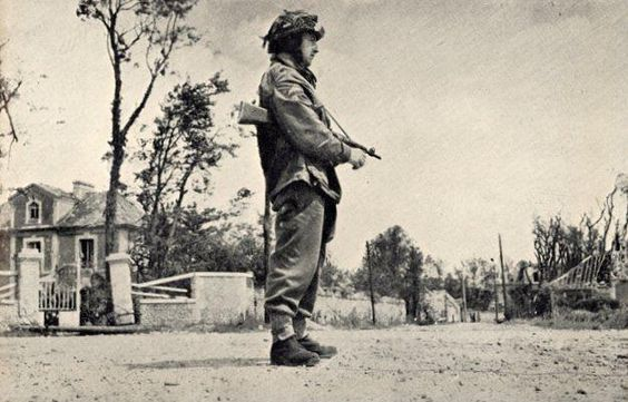 An Airborne soldier in a village to the east of the River Orne.