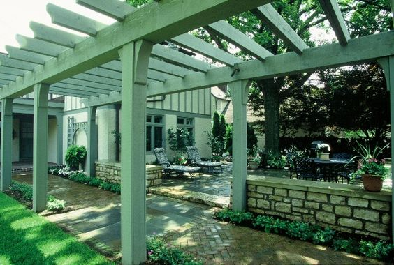 A walkway trellis can make a simple path feel like so much more. Built by Architectural Gardens Columbus | Ohio