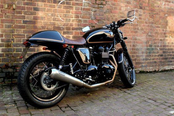 "Customized 2013 Triumph Thruxton (aka ""The Black Prince"").  Love the old-school pin striping."