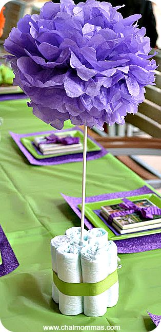 Baby Sprinkle Centerpiece - Blue or white poms - add paper or crystal rain drops, and use black/white or gold ribbons to tie diapers together.