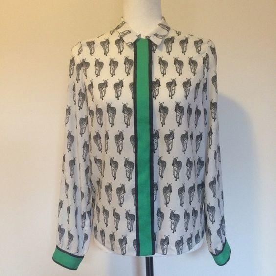 TopShop Zebra Print Blouse Quirky and chic! This blouse if perfect for the office or any day. It's feels skill and great on the body (all poly). I've had it for a year and cherished it's boldness. Fits anyone size 2-6.                                                                                                                      Save on shipping when you bundle!                                       30% off bundles of 2 or more!                                                        ▪️…