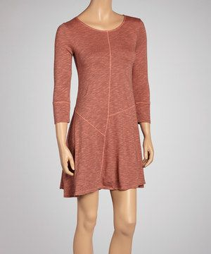 Boasting lightweight, breathable organic cotton, this dress is ultra soft. The formfitting silhouette with puzzle-like stitching is comfy and oh-so chic to boot.