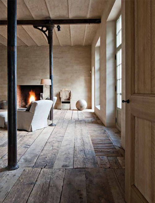 Breathtaking #rusticdecor by #AxelVervoordt in pale lofty room with stone and weathered wood - Swiss Barn Plank Flooring By Corvelyn