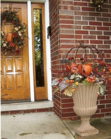 keep using the summer flower pots & urns - fill them with fall items, love the pumpkin frame An option for route to front door
