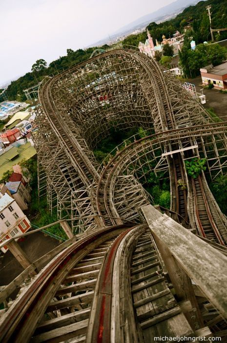 Spirals formed by the rotting wooden structure of this abandoned theme park roller coaster in Nara Dreamland, Japan.:
