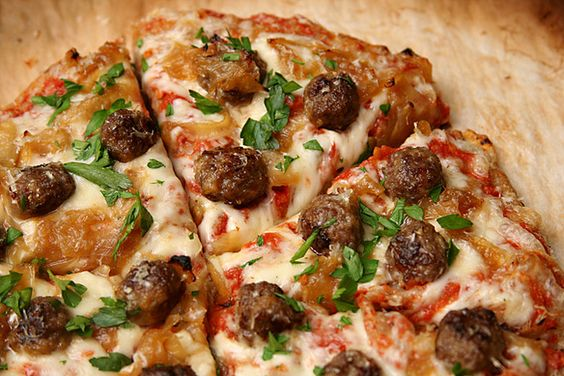 Pizza with lamb meatballs, caramelized onions, parsley