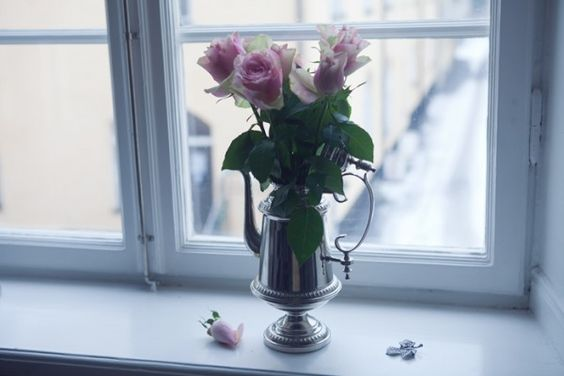 Pink blossoms in a silver jug