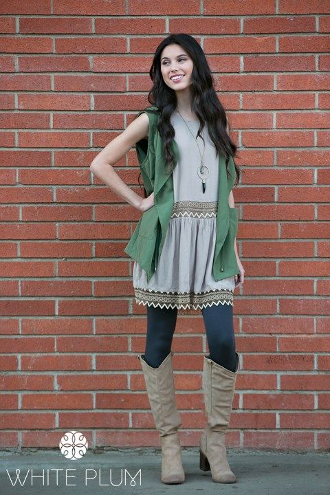 """Get a high fashion look in our Allison Cinched Vest! Understated yet super chic, the Allison is the ideal transition piece as spring approaches. Its fashionable draped style comes complete with a drawstring tie at the waist, two side pockets and a hood! Use this piece to dress up any simple ensemble with some leggings and booties.COLORSBlackOliveSIZESSmall (0-4)Medium (6-8)Large (10-12)Women's sizingModels are 5'7"""" and 5'9"""" - wearing size smallHand wash coldDo not bleachHang/line..."""
