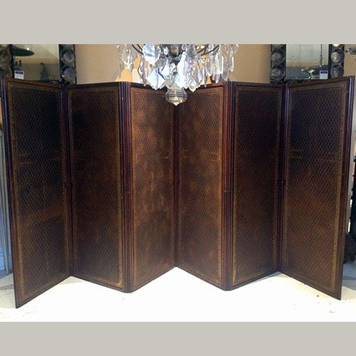 """18th Century French Double Sided Leather Screen. Both sides of screen feature lovely brown and black monogrammed leather. Screen features 7 folding sections.  When fully extended; 210""""w x 2""""d x 77.5""""h"""