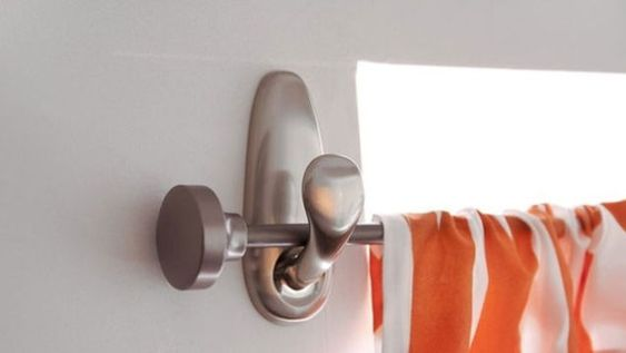 3M command hooks - hang curtain rods - good idea for sunroom where I don't want to drill etc. - 15 Brilliant Things You Can Do with Command Hooks