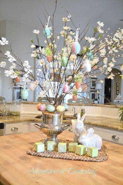 Easter egg tree - faux dogwood branches in a vase filled with plain branches and embellished with Easter ornaments: