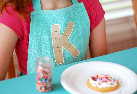 Cookie decorating party with dishtowel aprons and cookie garland