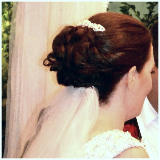 www.facebook.com/ericapstylist Bridal updo with accent clip and low veil