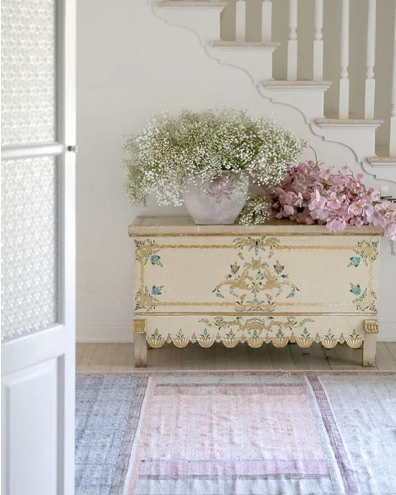 A beautiful vintage handpainted chest in a shabby chic foyer. #shabbychic