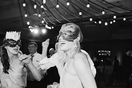 Wedding Guests Enjoying a Dance and Some Fun Venetian Masks #wedding #photography #weddingdetails