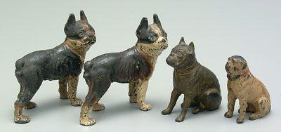 Four cast uron dog banks
