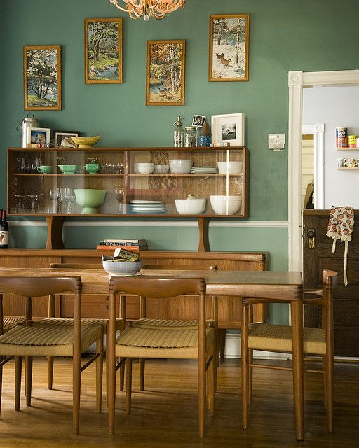 Mid-century Modern dining room. Love everything--the Danish dining set with china cabinet, the Dutch door and the paint by number paintings on the green wall: