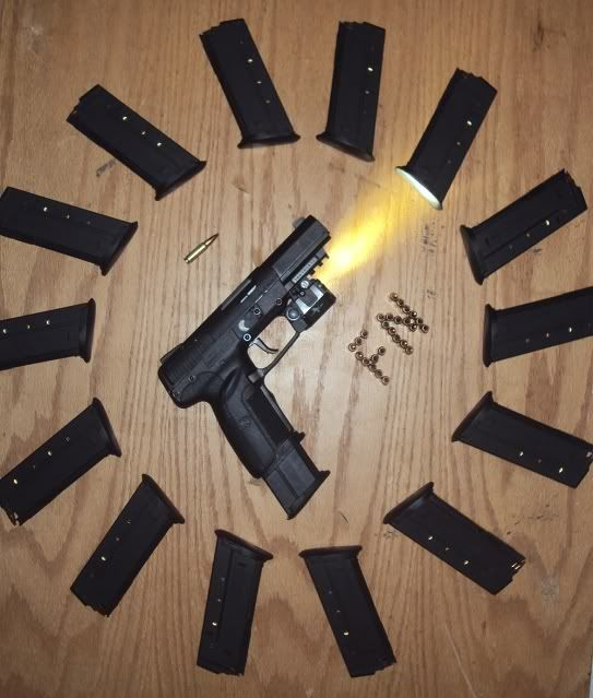 FN Five Seven with Viridian light/ laser and extended magazine