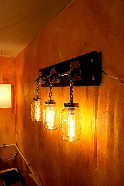 I don't know WHY I like this....but I REALLY, REALLY DO!  Such an original idea!  JARS OF LIGHT Industrial Mason Jar Lighting Sconce by MillerLights, $179.00