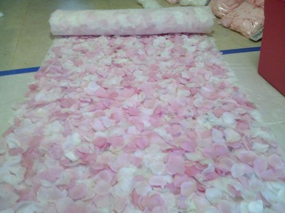 Make your own petal runners! Use Spray adhesive. Buy flowers at Dollar Tree. Link to calculate how many flower petals you'll need: http://www.petalgarden.com/petalcalc.htm: