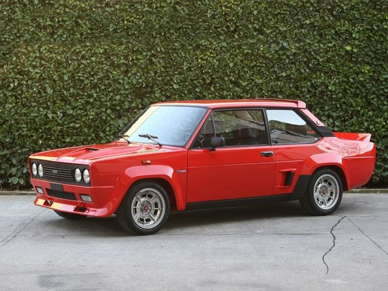 Fiat Abarth 131 Rally 1976. It remember reading a comparison with this and an RS2000 escort many years ago. As far as I was concerned the Fiat won hands down. Though this one is red it still looks pretty cool. Would I have one in my dream garage? probably not.