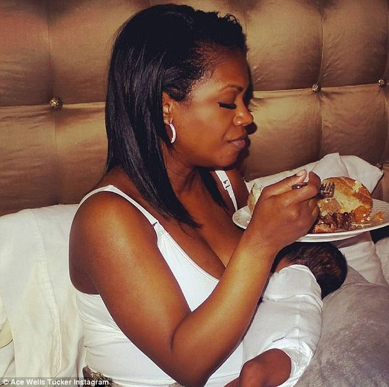 Lunch time! Kandi Burruss shared a snap of her eating a plate of food while breastfeeding her newborn son Ace on Wednesday