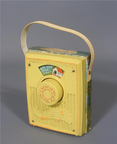 """This is a lovely vintage 1968 Fisher Price musical pocket radio  Plays """" Oh where has my little dog gone?""""     Pictures scroll past small screen  Wooden back with illustration and song words  One of the originals,  a toy classic that has delighted children for generations"""