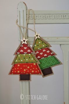 Handmade Fabric Christmas Tree decorations by Stitch Galore Decorated with appliqué and freehand machine embroidery.  www.stitchgalore.com