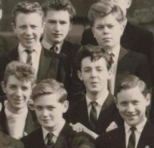 March 1960, 18 year old Paul McCartney with his Liverpool Institute classmates. Shortly after this photograph was taken, Paul McCartney left the Liverpool Institute to set off on a tour of the south of Scotland, Friday, 20th May, 1960, with The Silver Beetles who were backing Johnny Gentle