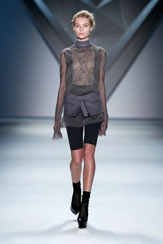 Steel silk chiffon crisscross appliqué and net lace long sleeve top with stand melton collar  and charcoal rib knit bermuda short with steel melton zip-front peplum.