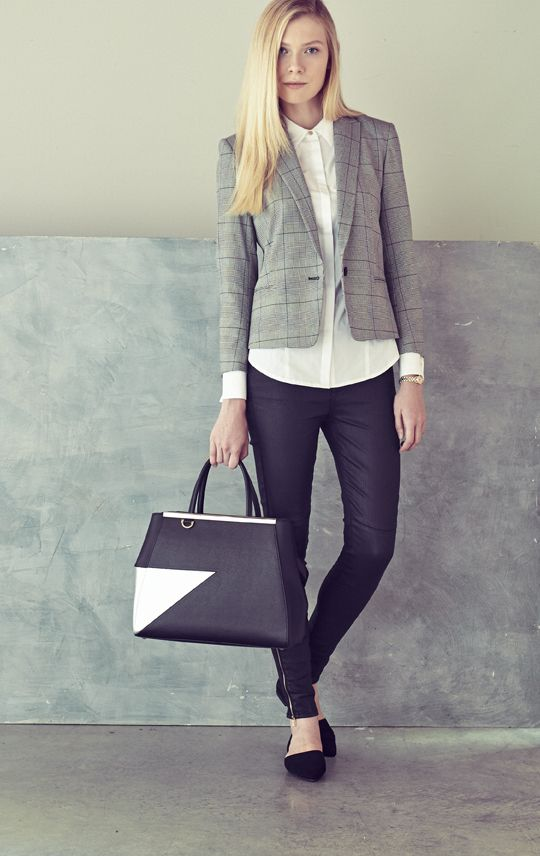 For a menswear-inspired look, pair coated denim with a tailor blazer and button-front shirt. Then add a structured leather tote and bracelet watch.