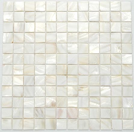 white glass mosaic tiles. Lovely, like seashells. Texture rather than clutter - I mean, rather than color....