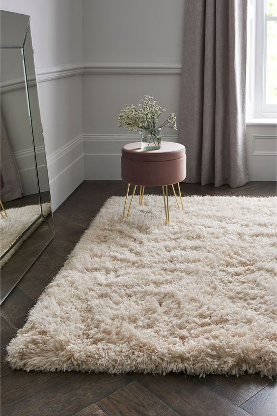 Love the feel of a fluffy rug under your feet? Perfect for a bedroom or a boho living room, this rug is truly sumptuous. #livingroom #bedroom #rug #bohointeriors #realhomes