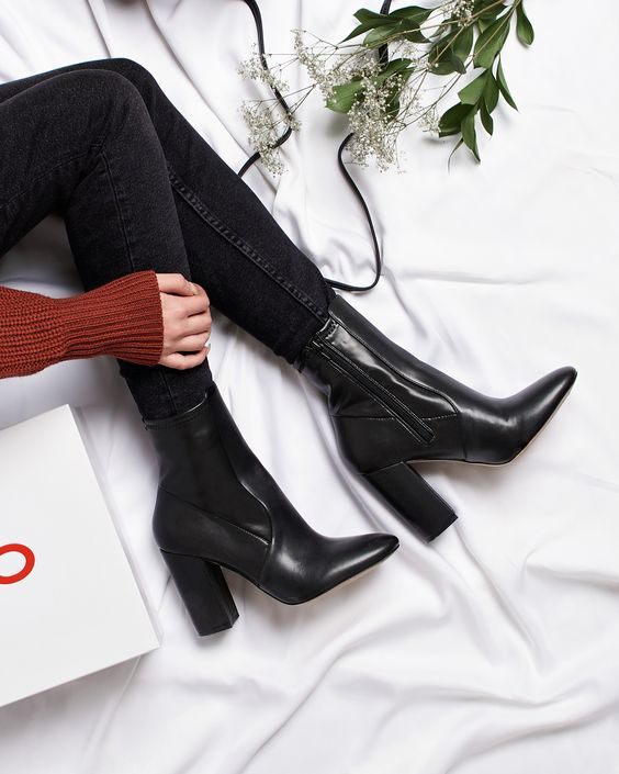 Step up your fall style in our Aurella boot-- with its almond toe, block heel, and flattering ankle height, it dresses up pants or skirts but also pairs perfectly with dresses and tights. This staple ankle boot walks the line between elegance and urban edge.  #Aldo #boots #blockheels #ankleboots