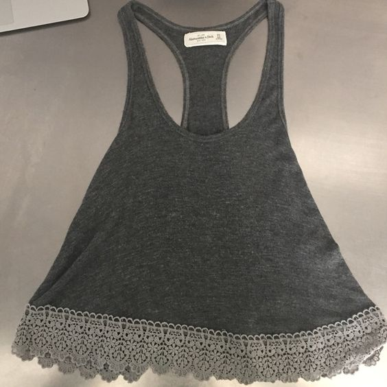 Abercrombie gray tank top Gray, soft tank top with light gray fabric design at the bottom. Very good condition, only worn twice Abercrombie & Fitch Tops Tank Tops
