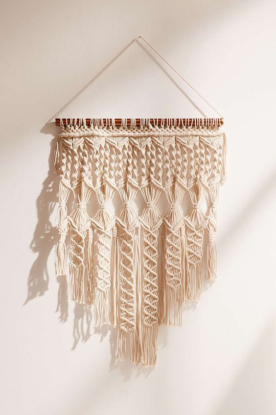 macrame wall hanging outfitters textured wall hangings are weaving their way into 3008