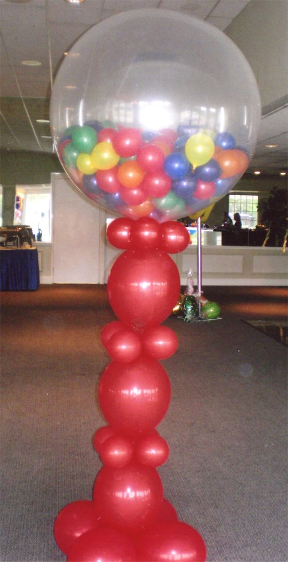 Nothing says fun like a giant gumball machine balloon for Balloon decoration machine