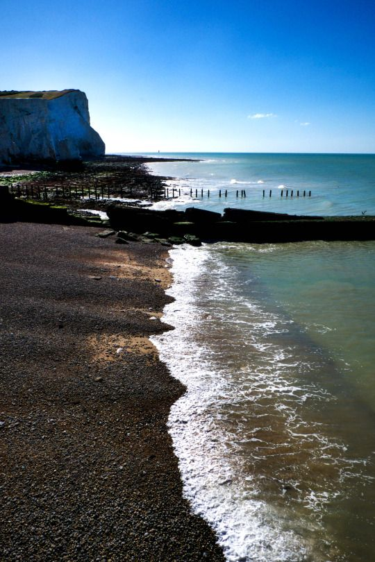Day 394 of 'A Photograph Every Day For The Rest Of My Life' Tuesday 23rd August 2016 On a Tuesday morning I alway's try to meet a good friend for breakfast and a walk along the beach in Seaford, East Sussex. She is a fellow 'sea swimmer' and so today we decided to have an early morning swim in the sea before breakfast. Today's photograph is of the start of the Seven Sisters cliffs at Seaford. A range of Gill's images are available to purchase in special edition at www.gillcopeland.com