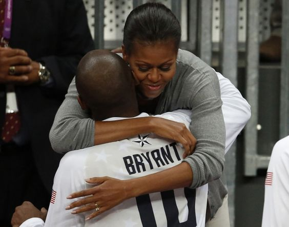 U.S. First Lady Michelle Obama hugs U.S. basketball player Kobe Bryant at the end of the men's preliminary round basketball match between the U.S. and France at the London 2012 Olympic Games. REUTERS/Luke MacGregor