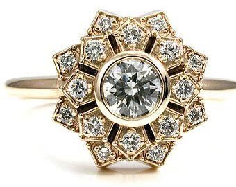 Pretty deco style bezel diamond ring.