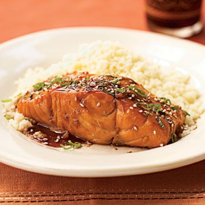 "Bourbon-Glazed Salmon Recipe: ""Bring the bourbon from the bar and into the kitchen. The rich flavor of the bourbon brings out both the saltiness of the soy sauce and the sweetness of the brown sugar. For those following a heart-healthy diet, the omega-3 fatty acids and low sodium in this dish make it a health no-brainer."""