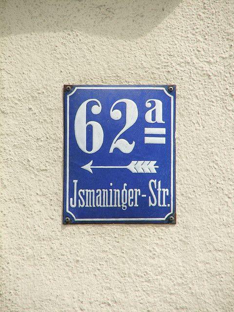 Ismaninger Straße 62a - Hausnummer by dustpuppy, via Flickr    Enamel sign from Munich, Germany. Nice arrow.