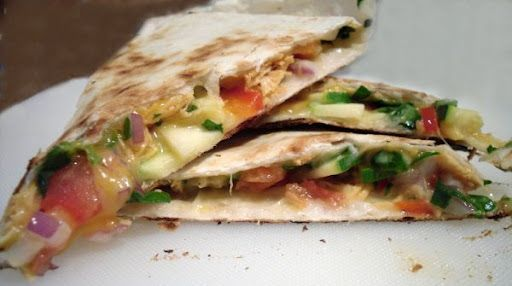 Freshly Loaded Quesadillas    Tortillas  Shredded Cheese (your preference)  Shredded or Cubed Chicken (*See note at end of recipe)  Thinly Sliced and Chopped Zucchini  Finely Chopped Red Pepper  Finely Chopped Red Onion  Finely Chopped Spinach  Finely Chopped Tomato  Whatever else you want