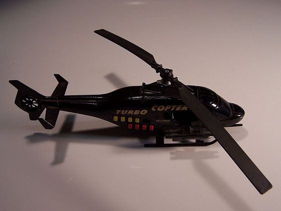 This Majorette Turbo Copter Helicopter, Sonic Flashers Series, plays 8 different Helicopter sounds. All 8 buttons activating the sounds work and each sound plays well. The battery is advertised as being permanent and plays over 10,000 times. The main prop rotates freely. It has missiles mounted on each side. All paint and graphics are in excellent condition.