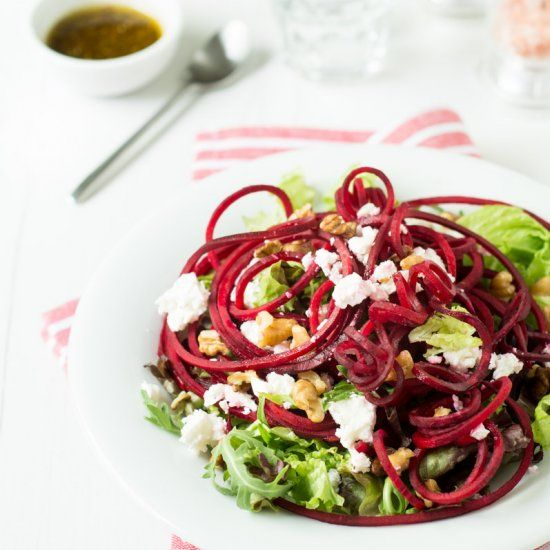 Raw spiralized beets and feta on leafy greens with walnuts and a balsamic vinaigrette!