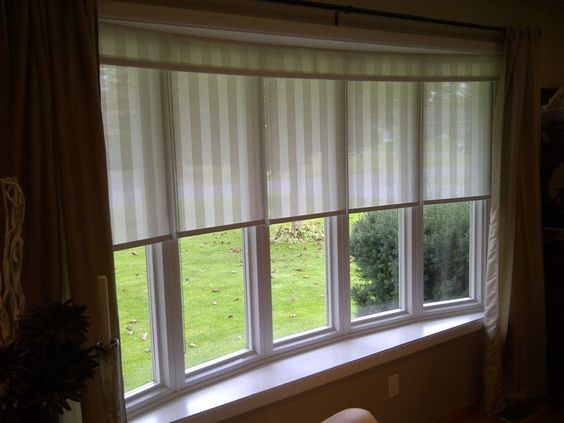 Window sun and rollers on pinterest for Blinds for bow windows ideas