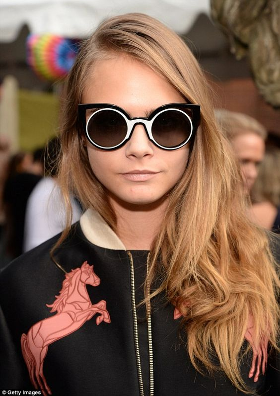 Mod glam: The 22-year-old model wore double-framed sunglasses with a nude lip and left her blonde tresses down and natural in a side-parting
